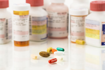 Close up of assorted pills and prescriptions