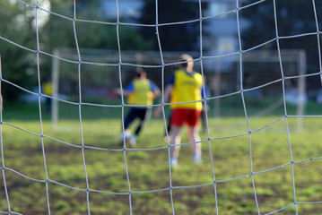 Soccer players in front of net