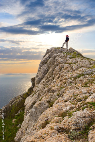 Active people - Person climbing a cliff