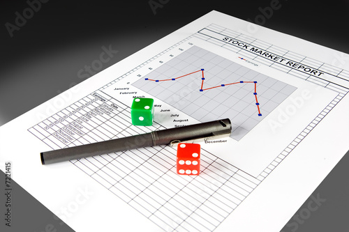 Stock market report and set of dice