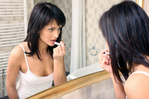 Young beautiful woman doing make up 2