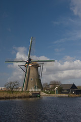 Dutch windmill at Kinderdijk against blue sky