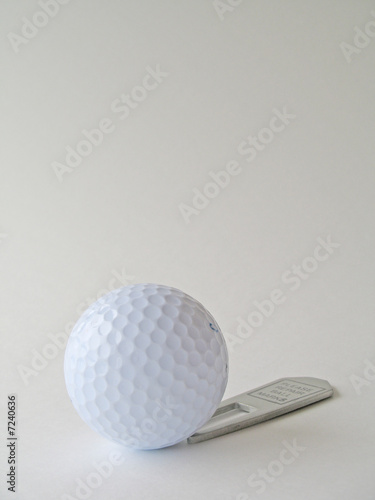 Golf ball and repair tool