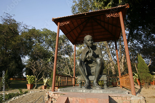 gandhi statue at rajghat memorial in new delhi, india