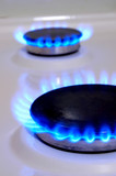 Flames of gas stove. Soft focus poster
