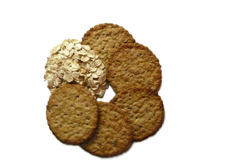 Oats and cereal crackers on white background