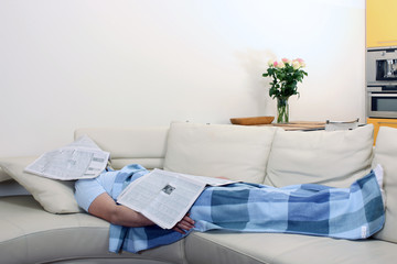 Man asleep under newspapers 2