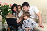 Happy family with a laptop