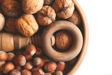 Mix of nuts in a wooden bowl