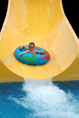 boy going down slide at waterpark