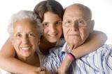 Fototapety granddaughter embracing her grandparents