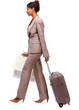 Businesswoman walking with travel luggage