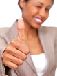 Business woman giving approval with thumbs up.