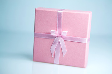 pink box gift with a pink ribbon