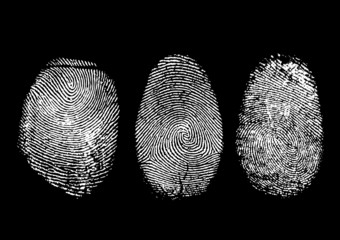 Three finger prints isolated on black