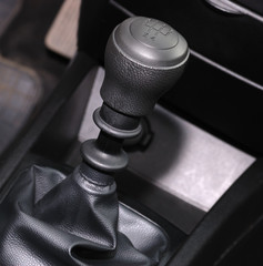 The handle of switching of transfers in the car