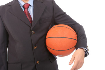 Business man holding basketball ball
