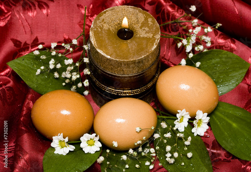 easter eggs with white flowers and candle