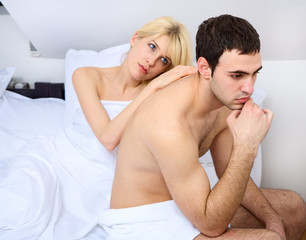 relationship difficulties of a young couple in bedroom