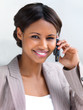 Smiling businesswoman using cellphone