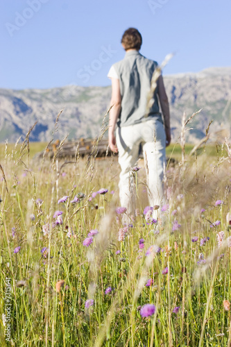Woman in a mountain meadow