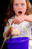 Young Girl Excited at Finding Seashell poster