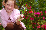 Young Girl Holding Wildflowers poster