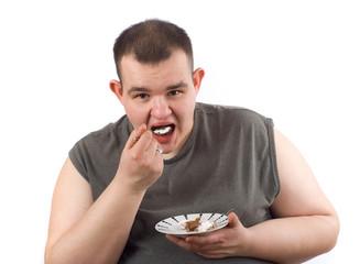 man eats cake