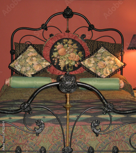 ornate iron bedstead