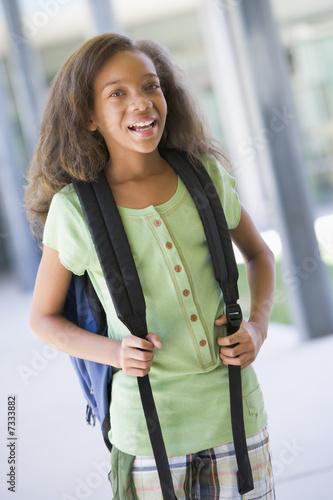 Elementary school pupil outside building