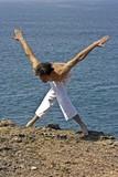 Yoga meditation posture on the rocks poster