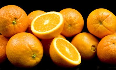 Halved Oranges on Black