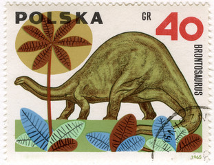 dinosaur (brontosaurus) on a vintage post stamp from Poland