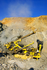 Drill machine in open pit