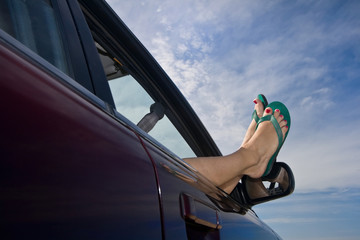 Relaxing with Legs Hanging Out of the Car Window