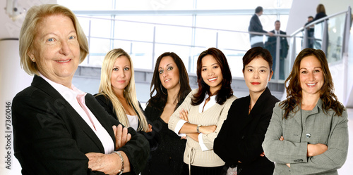 Mature female caucasian  leading a team of business women