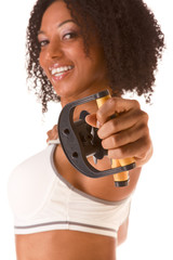 Ethnic female exercising with Resistance Band (selective focus o