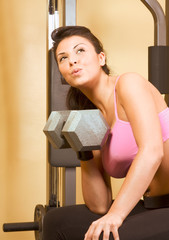 Woman dumbbell heavy weightlifting exercises