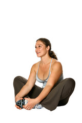 Beautiful active woman in sports attired sitting down