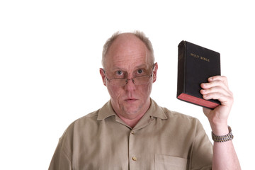 Old Guy in Brown Shirt and Glasses Holding up Bible