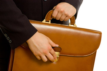 Businessman is opening his briefcase