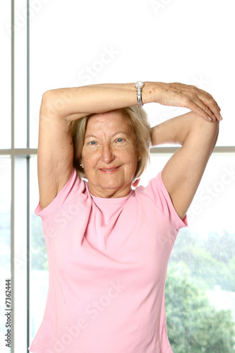 Beautiful mature woman doing her stretching exercise