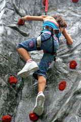 Young girl doing rock climbing