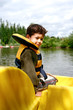 Young boy  enjoying a ride in the pedalo