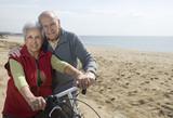 Active senior couple biking poster