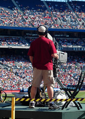television cameraman at major league baseball game