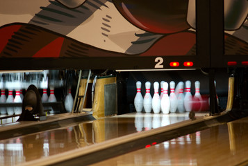 bowling pins being knocked down