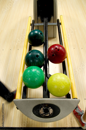 Bowling balls in the rack.