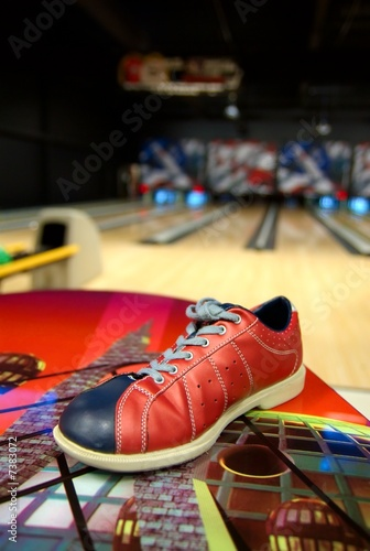 a bowling shoe on a table in alley