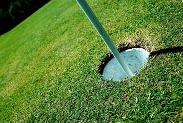 Golf course hole on green